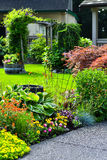 Manicured Yard. A beautifully manicured yard with a garden full of annuals and perennials Royalty Free Stock Image