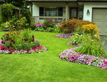 Manicured Yard. A beautifully manicured yard and garden full of perennials and annuals Stock Photos