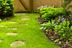 Manicured Yard. A beautifully maintained back yard with stepping stones Stock Image