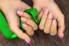 Manicures and ribbon Royalty Free Stock Photo