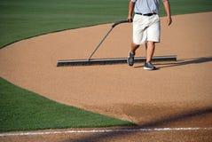 Manicuring The Baseball Field Stock Photo