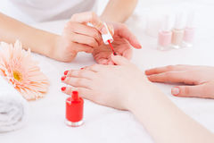 Manicurist in action. Royalty Free Stock Photos