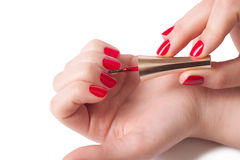 Manicurist applying red nail polish Stock Photography