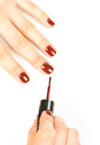 Manicurist applying red nail polish Royalty Free Stock Images