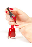 Manicurist applying red nail polish Royalty Free Stock Image