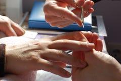 Manicurist cutting cuticles Stock Photo