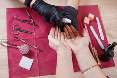 Manicurist disinfect hands with disinfectant spray. Disinfection in manicure, manicurist disinfect tools and hands, professional salon nails care, beauty and stock photo