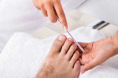 Manicurist Doing Pedicure. Close-up Photo Of A Manicurist Doing Pedicure Royalty Free Stock Image