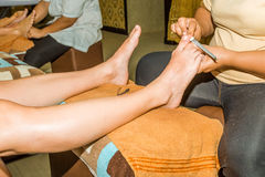 Manicurist doing pedicure Royalty Free Stock Photos