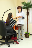 Manicurist holds customer hands in salon Stock Images