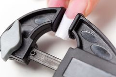 Manicurist make shape to enlarged acrylic nails Royalty Free Stock Images