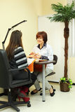 Manicurist makes manicure for woman Royalty Free Stock Images