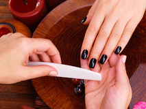 Manicurist master  makes manicure on woman's hands. Spa treatment concept Royalty Free Stock Photos