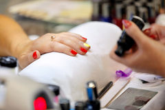 Manicurist master makes manicure on young woman hand.  Royalty Free Stock Images