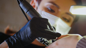 Manicurist in medical mask doing manicure in beauty shop Royalty Free Stock Photography