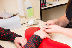 Manicurist Performing Gel Nail Manicure with Wraps. Close Up of Manicurist Wrapping Finger Nails of Female Client in Foil Wraps During Gel Manicure in Spa Stock Image