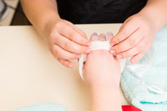 Manicurist Performing Paraffin Wax Treatment Royalty Free Stock Photography