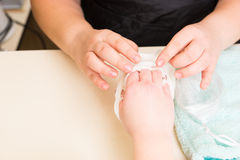 Manicurist Performing Paraffin Wax Treatment. High Angle Close Up View of Manicurist Peeling Dried Wax Layer from Hands of Female Client During Paraffin Wax Spa Stock Photography