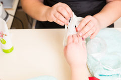 Manicurist Performing Paraffin Wax Treatment. High Angle Close Up View of Manicurist Peeling Dried Wax Layer from Hands of Female Client During Paraffin Wax Spa Royalty Free Stock Photos
