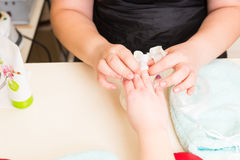 Manicurist Performing Paraffin Wax Treatment. High Angle Close Up View of Manicurist Peeling Dried Wax Layer from Hands of Female Client During Paraffin Wax Spa Royalty Free Stock Images
