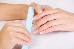 Free Manicurist Polishing Female Fingernails Stock Photos - 11682343