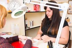 Manicurist Preparing Tools for Spa Manicure Stock Photo