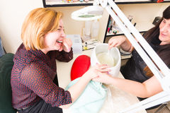Manicurist Prepping Client Hands for Wax Treatment Royalty Free Stock Photography
