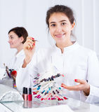 Manicurist showing color schemes Royalty Free Stock Image