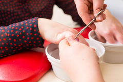Manicurist Trimming Cuticles During Manicure Royalty Free Stock Image