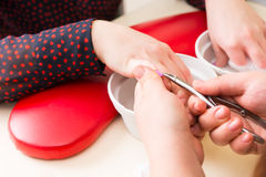 Manicurist Trimming Cuticles During Manicure Royalty Free Stock Photo