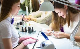 Manicurist at work in the beauty salon. Hand care Stock Photography
