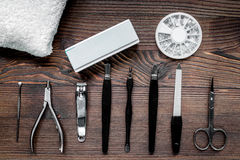 Manicurist work with manicure set for hands care wooden background top view Royalty Free Stock Image