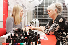 Manicurist at work Royalty Free Stock Image