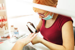 Manicurist working on client nails Stock Photography