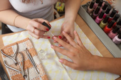 Manicurist working with   nails Royalty Free Stock Photos