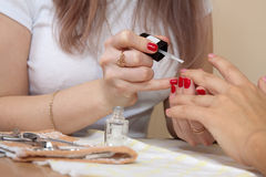 Manicurist working with nails Royalty Free Stock Images
