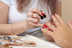 Manicurist working with   nails. Manicurist working with  woman nails Royalty Free Stock Photos