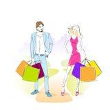 Manier winkelend paar met handelsreiziger en vrouw Royalty-vrije Stock Fotografie
