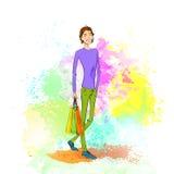 Manier winkelende toevallige mens met zak over kleurrijk Stock Fotografie