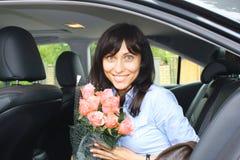Maniermeisje met bloemen Stock Afbeelding