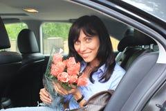 Maniermeisje met bloemen Stock Fotografie