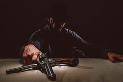 Manieur de pistolet occidental sauvage Photographie stock