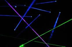 Manifestazione del laser ad un concerto in tensione Fotografia Stock