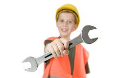 Manifestazione del ragazzo una chiave a forchetta Fotografia Stock