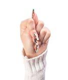 Manifestazione della mano della donna il fico Immagini Stock
