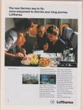 Manifesto che annuncia le linee aeree di Lufthansa in rivista dal 1992, il nuovo modo tedesco pilotare slogan fotografia stock libera da diritti