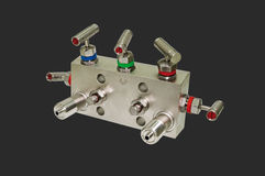 Manifold block. Manifold block for the differential sensor. Isolated on a dark gray background Stock Photo