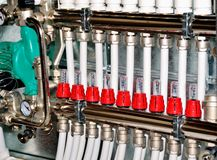 Manifold, collector for heating of a floor stock photo