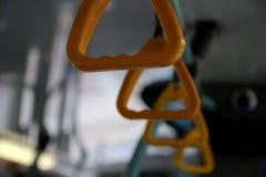 Maniglia del fondo della sfuocatura del bus fotografia stock
