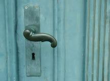 Maniglia sul portello verde Immagine Stock